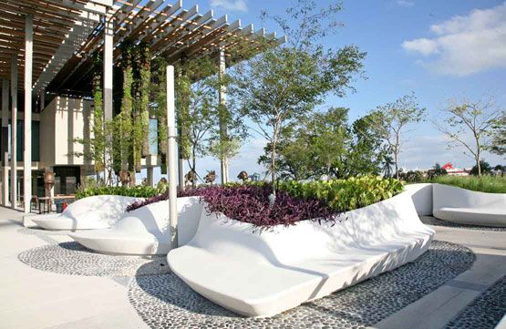 Planter Beds Double As Benches In An Attractive Undulating