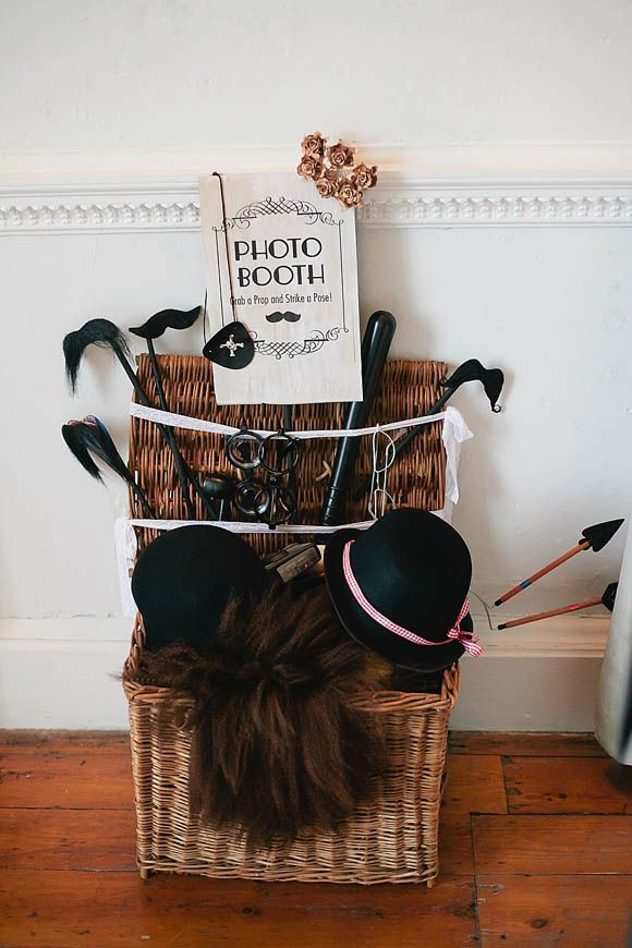 Home made photo booth with props. From http://www.lovemydress.net/blog/2013/01/agatha-christie-poirot-wedding.html.