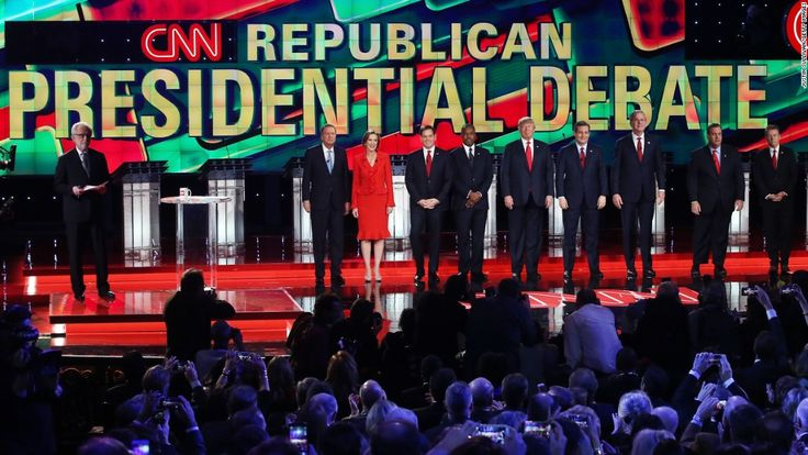LAS VEGAS, NV - DECEMBER 15:  (L-R) CNN anchor Wolf Blitzer looks on as Republican presidential candidates Ohio Gov. John Kasich, Carly Fiorina, Sen. Marco Rubio (R-FL), Ben Carson, Donald Trump, Sen. Ted Cruz (R-TX), Jeb Bush, New Jersey Gov. Chris Christie and Sen. Rand Paul (R-KY) are introduced during the CNN presidential debate at The Venetian Las Vegas on December 15, 2015 in Las Vegas, Nevada. Thirteen Republican presidential candidates are participating in the fifth set of…