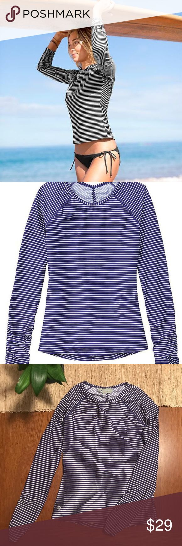 Athleta Gardenia Grove Rashguard, Blue Stripe, XS Sold Out! Gardenia Grove Rashguard, Amalfi Blue Stripe - Chic blue and white stripes jazz up the good looks of this performance rashguard that protects your skin from board rash. Fun, sporty top to get you ready for the beach! Gathering on back and sleeves. Cover photo shows same top in black and white. Athleta Swim