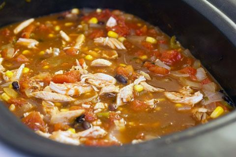 This recipe consists of opening cans and pouring them in the Crock-Pot and  as a bonus it tastes amazing. It cooks for four hours so it is perfect for  putting on before you go to Church or four hours before dinner. Thank you  Shelise Brown Thompson for sharing this wonderful recipe with me.  Ingredients:  4 chicken breasts - frozen 1 can of corn - drained 2 cans black beans, rinsed and drained 1 can diced tomatoes 1 can green enchilada sauce 1 can diced green chilies 1 can chicken broth…