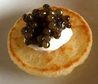 Roll this delicious caviar between your tongue and the roof of your mouth, allowing the caviar to soften slightly. Then break the eggs against the roof of your mouth for the full flavor experience. Always use of mother of pearl spoon, as stainless steel flat wear will impart a tinny taste to the caviar. Alternatively, enjoy this Golden Russian Caviar on blini or low salt potato chip with creme fraiche. [ www.enjoyfoiegras.com ]