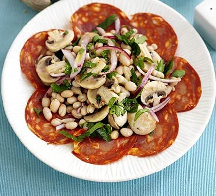Garlicky bean salad with chorizo. Re-create a taste of Spain in your garden with this tapas style salad, perfect for nibbling on in the sun