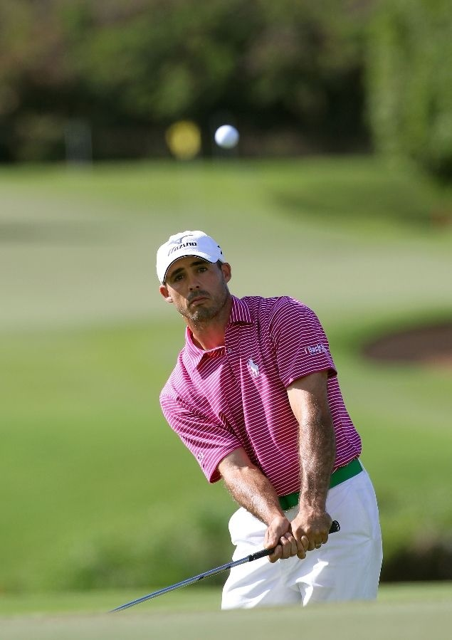 Love Jonathan Byrd's neon golf belt.