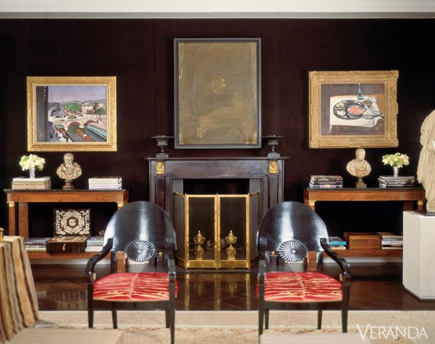 Walls in Elitis velvet from France and ebonized wood floors showcase art in interiors by Luis Bustamante.