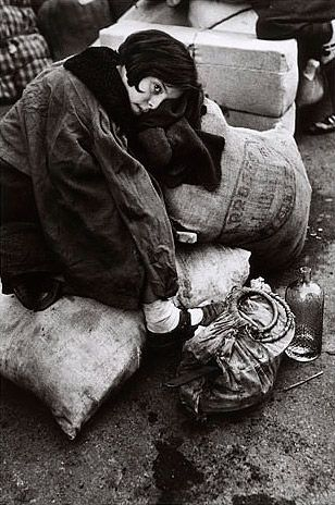 Young girl at refugee transit center, Barcelona, Spain. Jan. 15-1939 - Robert Capa