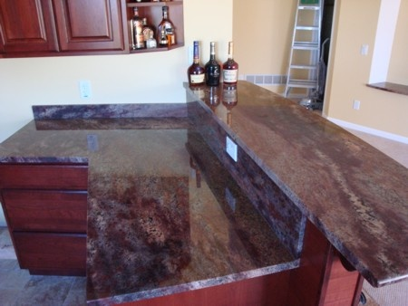 Kitchen with red cherry cabinets and Crema Bordeaux ...