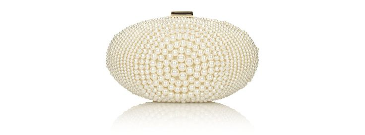 White clutch bag made from high quality synthetic material to spruce up all kinds of evening creations.     The pearl motifs, inspired by this season's fashionable  Future hardware  trend, are an ever fashionable and exclusive decorative feature of an elegant dress.   The gold hardware adds a certain charm.   This bag can be slung on the shoulder thanks to the gold chain that functions as a strap.   The compact format accommodates all a woman's essentials.   Snap closure.     The ladies'…