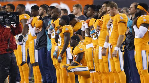 Miami Dolphins free safety Michael Thomas, center, kneels during the national anthem before the team's NFL football game against the Cincinnati Bengals, Thursday, Sept. 29, 2016, in Cincinnati. (AP Photo/Gary Landers)