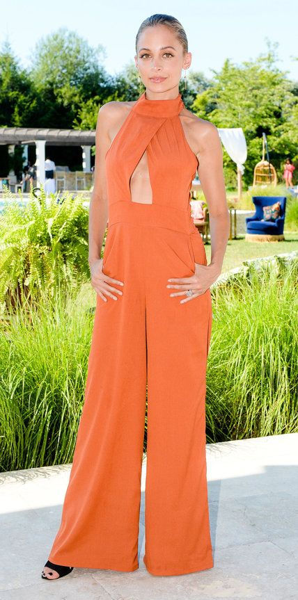While Nicole Richie's burnt orange jumpsuit could totally work for an evening out, we love how she styled it for a day in the Hamptons: with barely-there jewelry and a simple black sandal | from InStyle.com