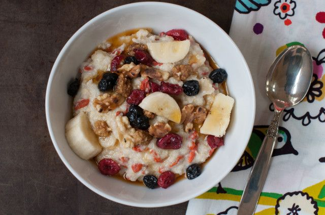 5 minute hot quinoa cereal with dried berries, walnuts, bananas, and maple syrup. Hearty and healthy.