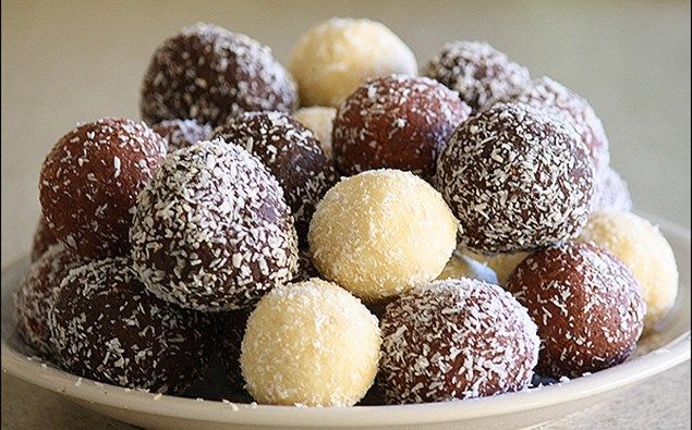 TIM TAM BALLS! - One of the easiest and most delicious recipes ever. Good luck with just stopping at one! Ingredients: 2 packets of Tim Tam's 3/4 can of 39