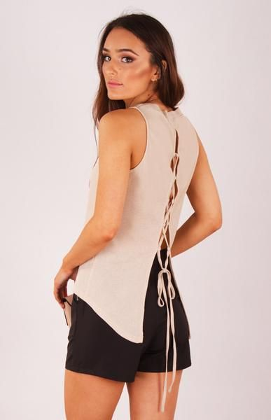 Because who said basics have to be boring? This top features a slightly open back, including an on trend lace up detail and ribbed fabric. It's business at the