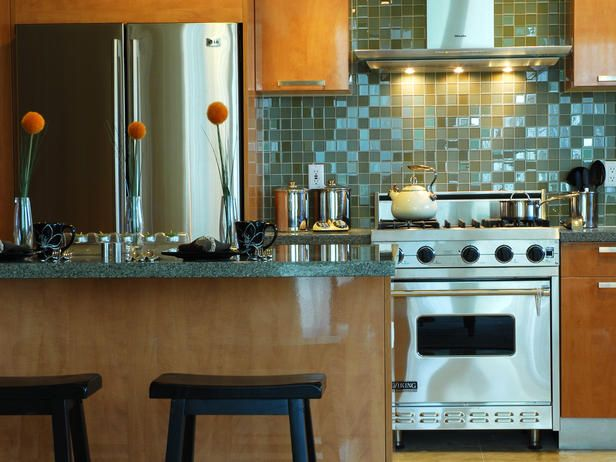 I absolutely love the backsplash tiles! Glossy backsplash with stainless steel appliances