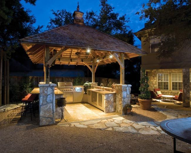 Built for entertaining, this outdoor kitchen is equipped with all the essential items for fiestas. It is outfitted with a stereo system and televisions, as well as a gas grill, infrared burner and a smoker.