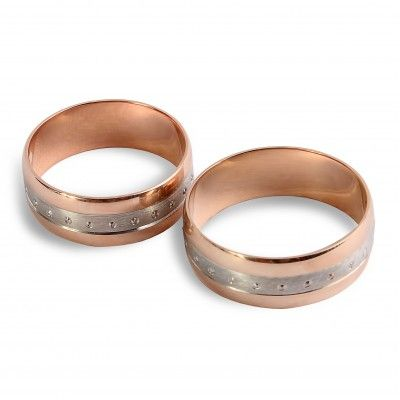 """Обручальное кольцо Вместе навсегда 10245 Обручальное кольцо из красного и белого золота """"Вместе навсегда"""". Коллекция """"Ценности"""" …олицетворяет гармонию двух влюбленных, соединивших свои судьбы навсегда… Классическая скругленная форма кольца в красном золоте 585 пробы дополнена посредине лаконичной и изящной точечной гравировкой на металле, выполненной в белом золоте. Ширина шинки – 6 мм. Вес: 3.4-4.7 Проба: 585 Материал: золото Цвет золота: красно-белое 2720.00 грн В наличии"""
