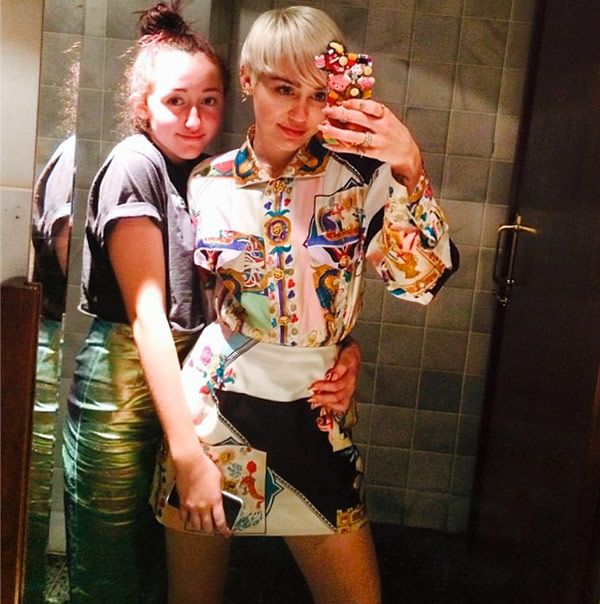 Miley Cyrus: Out At A Barcelona Nightclub In A Mini With Her Sister