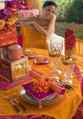 Vibrant orange and hot pink reception tablescape.