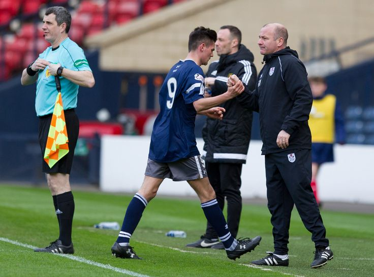 Gus MacPherson congratulates his son Ewan during the Ladbrokes League One game between Queen's Park and Albion Rovers