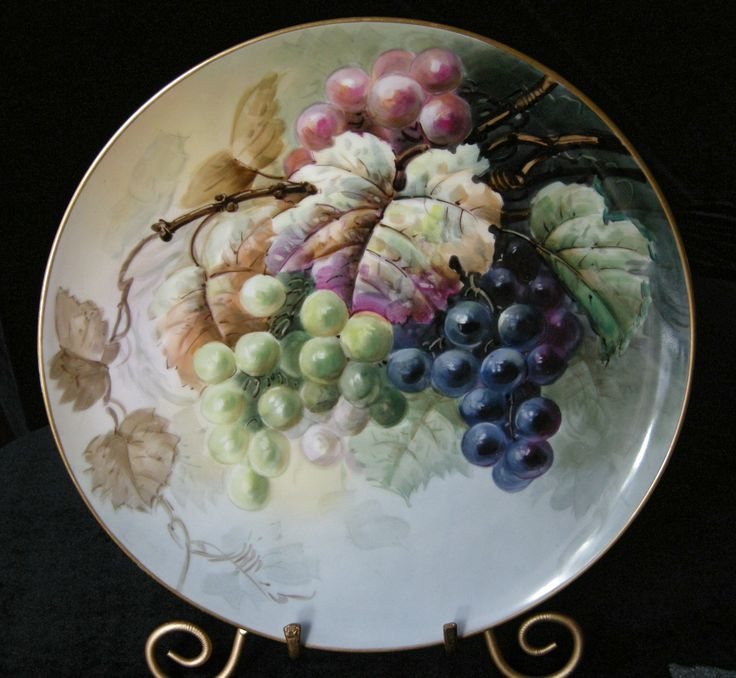 gorgeous antique handpainted T Limoges porcelain charger with rich, plump Grapes. The edge is gilded and 99% intact. It is marked with the Tressemann and Vogt Limoges mark 10 and this dates it 1892- 1907.