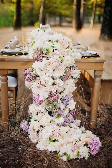 A beautiful floral table runner cascading from the end of the table. Source: Style Me Pretty #tablerunners #floralrunner #tabledecor