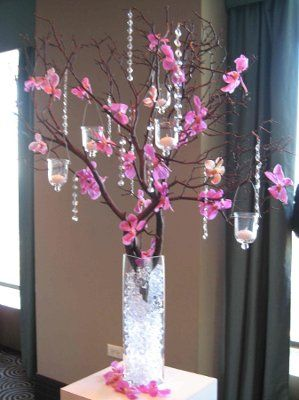 Idea for centerpieces - love the branches the most with the tea lights, not a fan of the hanging crystals