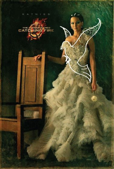 Katniss's new Catching Fire poster. The wedding dress with the mockingjay built in.... didn't see that.