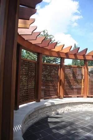 Unique Privacy Screen and Pergola. Supplied by Kayu Canada Inc. Built by Sundance Landscaping.