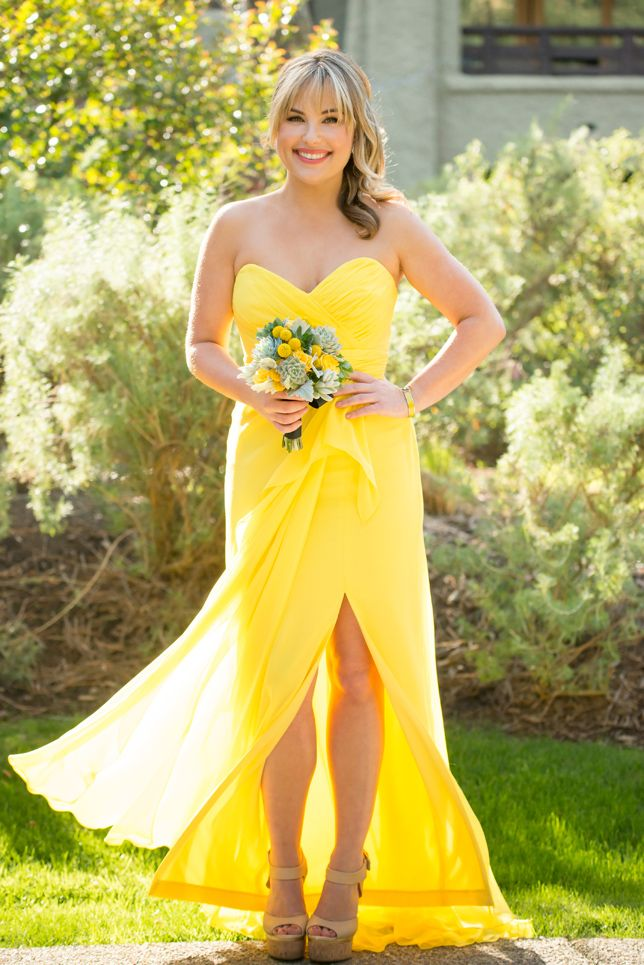 Such a gorgeous bridesmaids dress!  A yellow sweetheart maxi dress with side swept ponytail.