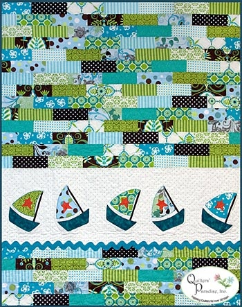 Nautical baby Quilt! Fun & easy jelly roll creation with a little machine applique thrown in!  Quilter's Paradise made another cutie!