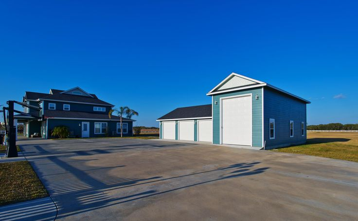 Brand new 4 car garage.  1 extra large bay for your toys, boats, or RV