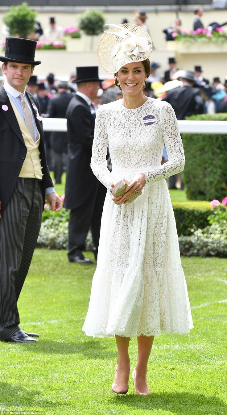 The Duchess of Cambridge chose a white lace dress by Dolce and Gabbana for her first visit...