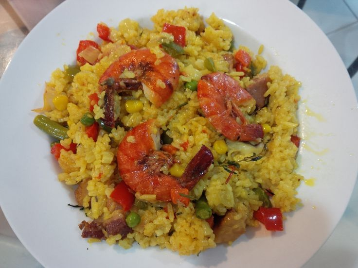 Paela ala Dharmawan Sutanto, using long grain rice and tumeric