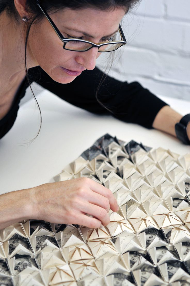 Francisca Prieto at work on her intricate folded paper works.