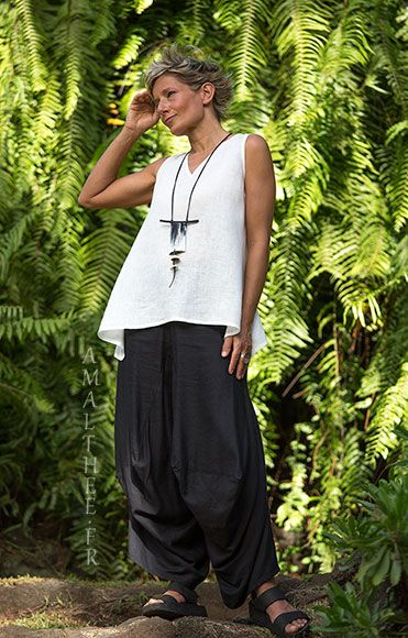 Loose fit black linen pants with drape legs. Beautiful two tones Horn ZEN PENDANT with rare ancient Conus Shells from Mauritania, waxed cotton cords