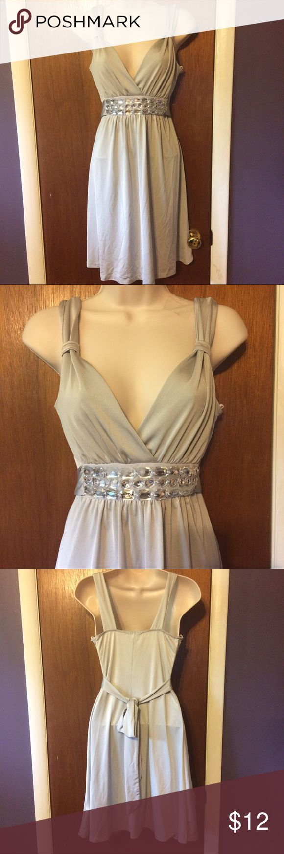Silver mini dress Silver mini dress with clears jewels. The size is not on the tag but it fits my mannequin like a small Dresses Mini