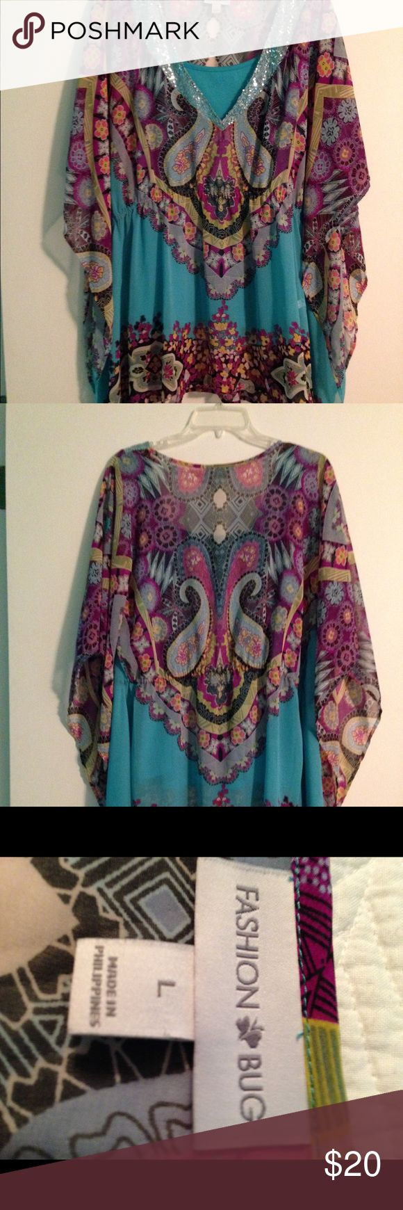 Fashion Bug butterfly top Fashion Bug butterfly top with attached tank top. Size L. Bust 40-42, length 32 100% polyester.  Threads holding tank top in place could easily be snipped & use the top for a swimsuit cover up.  Mint condition. Fashion Bug Tops Tunics