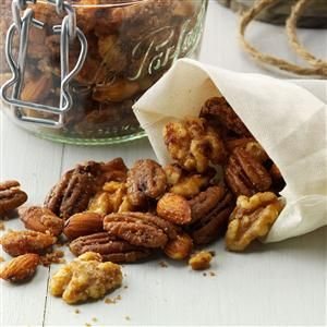 Slow Cooker Candied Nuts Recipe -I like giving spiced nuts as holiday gifts. This slow cooker recipe with ginger and cinnamon is so good, you just might use it all year long. —Yvonne Starlin, Hermitage, Tennessee
