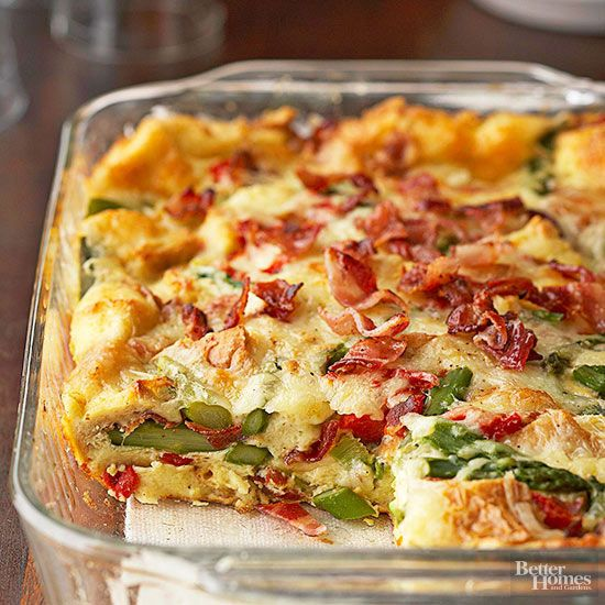 Bound together by fluffy eggs, this baked breakfast casserole is filled with crispy bacon and crunchy asparagus that complement each other well. Assemble the night before you have guests for an easy breakfast recipe.