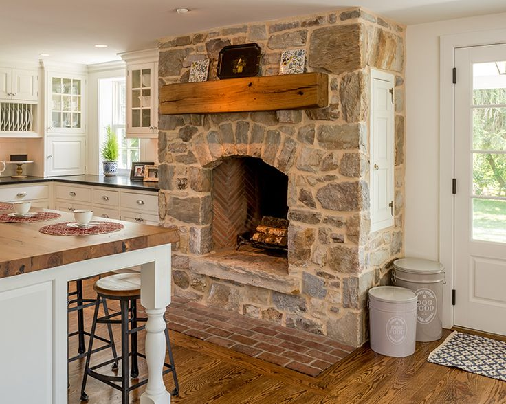 Colonial Kitchen Wood Floors Stone Fireplace In The Butcher Block Counters