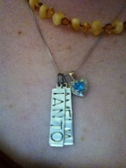 Capture your grief, day eight: Jewelry. I don't wear much jewelry at the moment, but this necklace never comes off. Scott bought me the chain with the blue heart for my 18th birthday, to match a ring he bought for our first anniversary as a couple. I added the kids' names, ordered from Etsy.