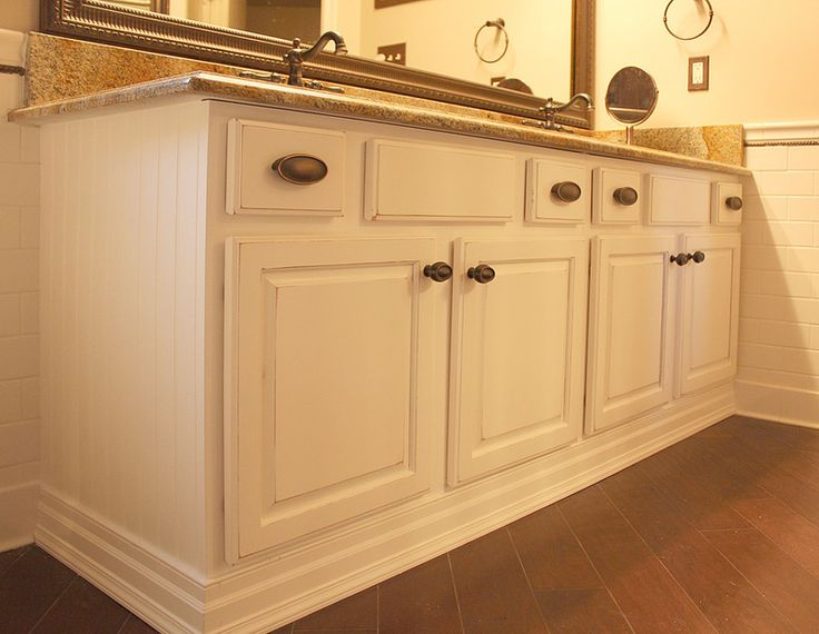 A distressed off white lacquer finish transformed that for Add beadboard to kitchen cabinets