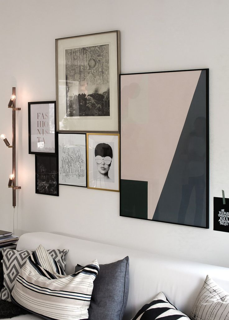 I like the way the frames are all touching. I wouldn't want to do an entire wall that way, but a small area like this looks good. | Mad About The House