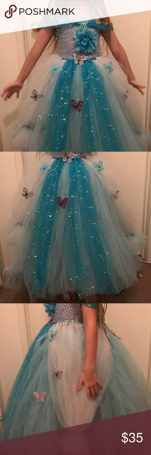 Cinderella Tutu Dress Handmade Cinderella Tutu Dress. Has an under layer of white tulle. Two layers of blue tulle. And then the decorations tulle (white on the hips tied into a bow. Blue sequins tulle in the front .) adorable butterflies all over the front and sides. Dresses
