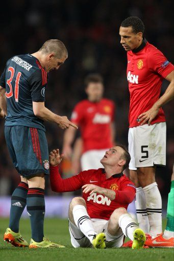 Bayern Munich's Bastian Schweinsteiger (left) shows an accusatory finger to Manchester United's Wayne Rooney after receiving a red card for a second bookable offence