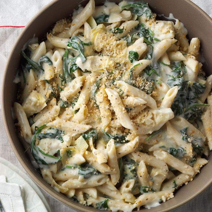 Artichoke Florentine Pasta Recipe -Pasta loaded with artichokes and creamy cheese is everything a Sunday dinner should be: rich, tasty and memorable. Add cooked chicken, shrimp or crab if you like. —Nancy Beckman, Helena, Montana
