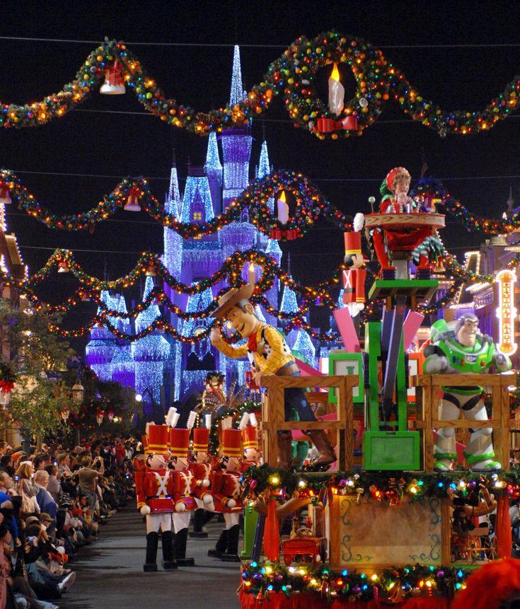 Christmas Parade down Main St USA in Magic Kingdom.   facebook.com/PixieTrips
