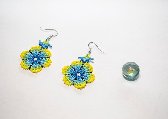 Hand-crafted native Mexican Huichol Peyote Flower beaded earrings. These earrings were made with the Aikutzi technique which has been passed through generations and was originated in the highlands of central Mexico. In the Huichol language the word Aikutzi means blessing of the goddess. These beaded earrings feature the Peyote flower which is the symbol for life and success in the traditional Huichol art. For the Huichol, beaded jewelry is not only an aesthetic or commercial artform. The…