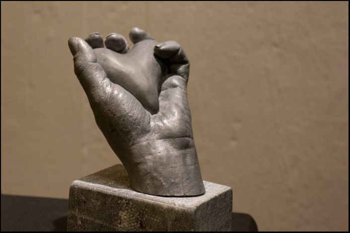 We make molds out of almost anything. Here's a hand holding a black concrete heart. The hand is made in epoxy and aluminium powder.  We make louds of body moulds. From pregnant bellys to hands.  The picture was taken when the work was in progress. It's not the finnished product, but close to it :)