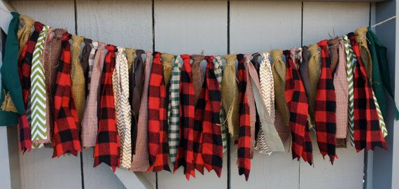 """Lumberjack Bunting Buffalo Plaid by AmpersandGO @ Etsy. Combo of lumberjack red buffalo plaid and rustic brown burlaps. Sewn along the edges in a scallop pattern so they can fray--just not that much. This bunting is hand tied onto jute twine to the distance of about 3' for an overall total of 5' end to end. The fabric edges are raw and frayed on purpose and the rags hang down ~10"""" on the longest strips."""